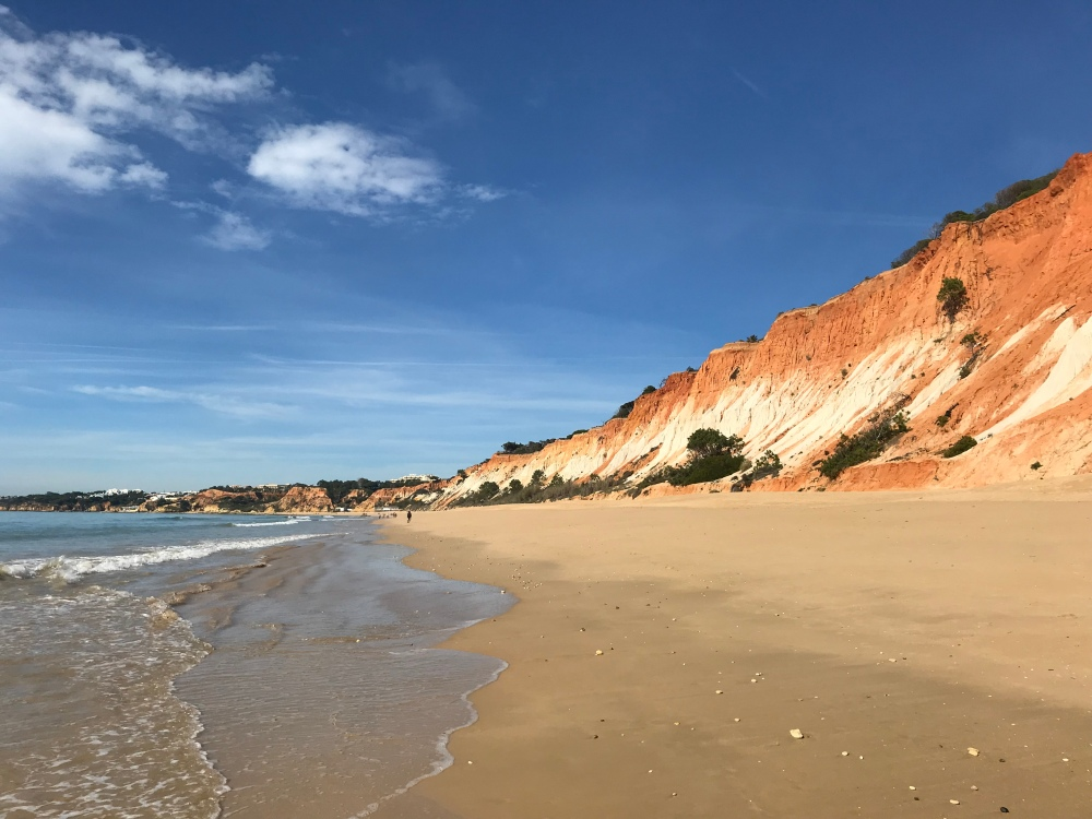 The view towards Olhos from Praia da Falesia with the stunning orange cliffs to the right and the sea to the left, with the beautiful sandy beach in front of me